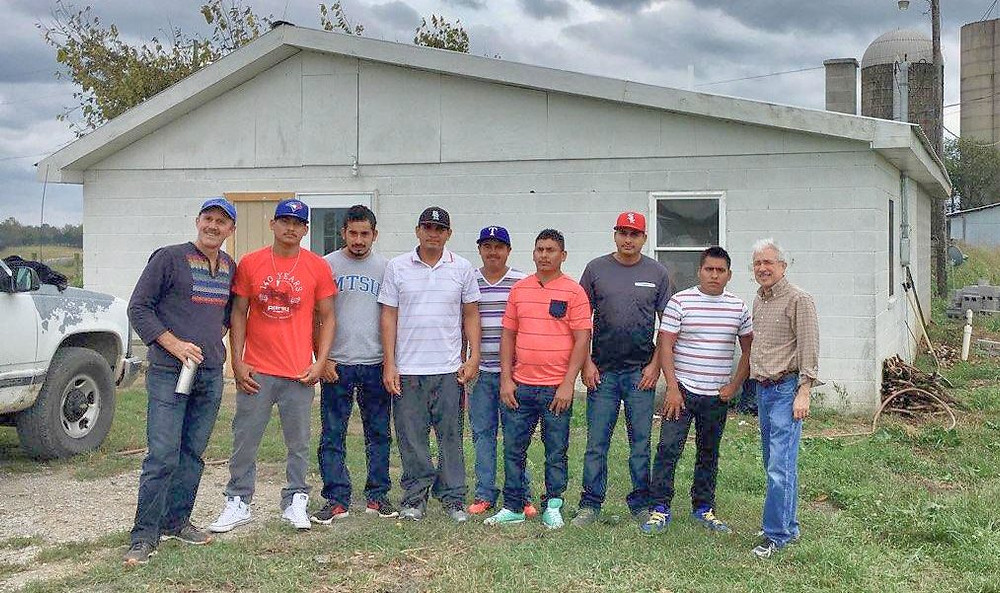Stephen Bartlett of FLOC (left) with striking farm workers Lamberto Gonzales, Fernando Guzman, Francisco Gonzales, Hernan Quezada, Jose Gonzales, Cristian Santillan, Adolfo Osorio; and Felix Garza of the National Farm Worker Ministry.