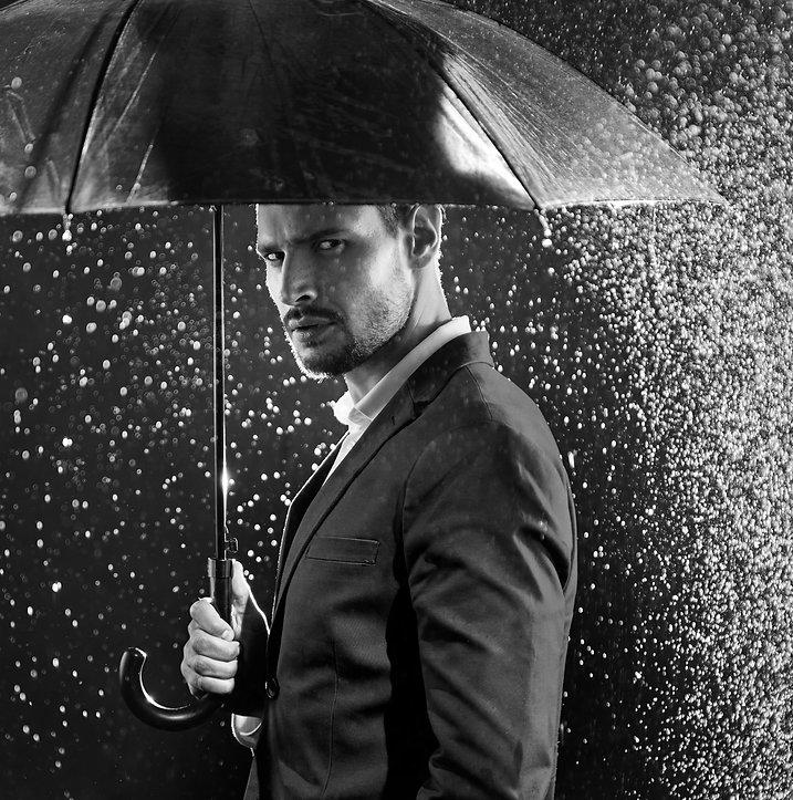 Handsome businessman under an umbrella,