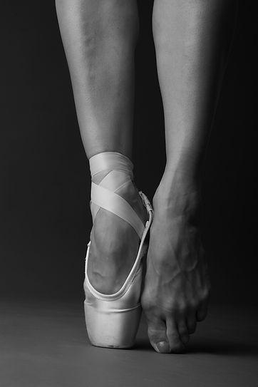 Standing on tip-toe, ballet dancer.jpg