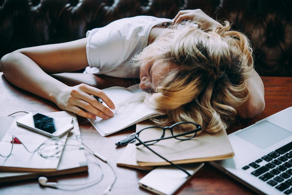 A tired teenage girl sleeping on her tab
