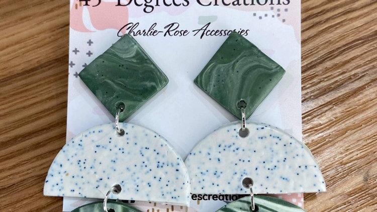 Green swirl dangly earrings