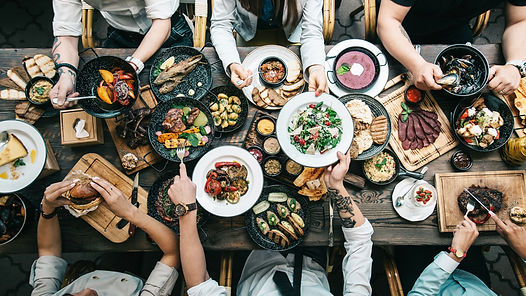 banquet-friends-variety-of-food-dishes-table-top-view.jpg