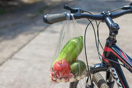 Fruit bags hanging on the bike handlebar