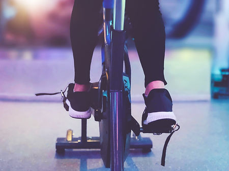 Close up Bike with fitness woman legs wo