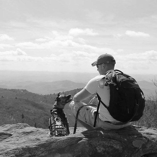 "U.S Marine Corps Veteran Ian with his service dog ""Jasmine"" hiking in the Smokey Mountains"