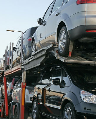 semi-towing-cars_gettyimages.jpg