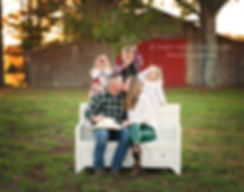 Christmas family photography on farm in north georgia. Kids holding up mistletoe over parents kissing. white bench