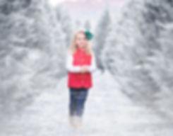 little girl in snow at bottoms christmas tree farm in cumming ga