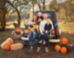fall family photography at milford family farm in cumming georgia with rustic black truck and pumpkins
