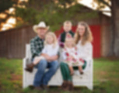 north georgia farm family photography in field, parents with kids on white bench
