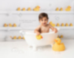 baby in clawfoot tub with rubber duck theme photography photo shoot after cake smash