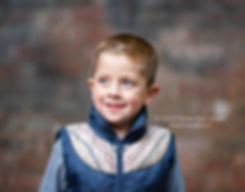 little boy against brick wall, child photography in roswell ga park
