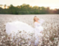 pregnancy maternity photography in flowing white dress gown standing in cotton field in cartersville georgia