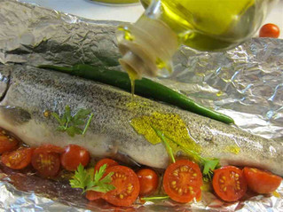 Oven baked trout bathed in olive oil