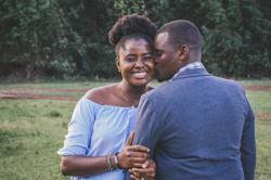 man-kissing-left-cheek-of-smiling-woman-