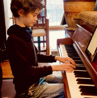 Piano student doing fun ear training with iReal Pro app
