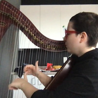 Harp student playing at online recital