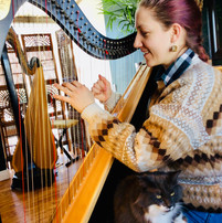 Student taking harp lessons at Harp on the Hill Studio