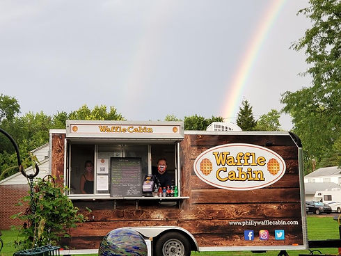 Waffle cabin with a rainbow and josh and