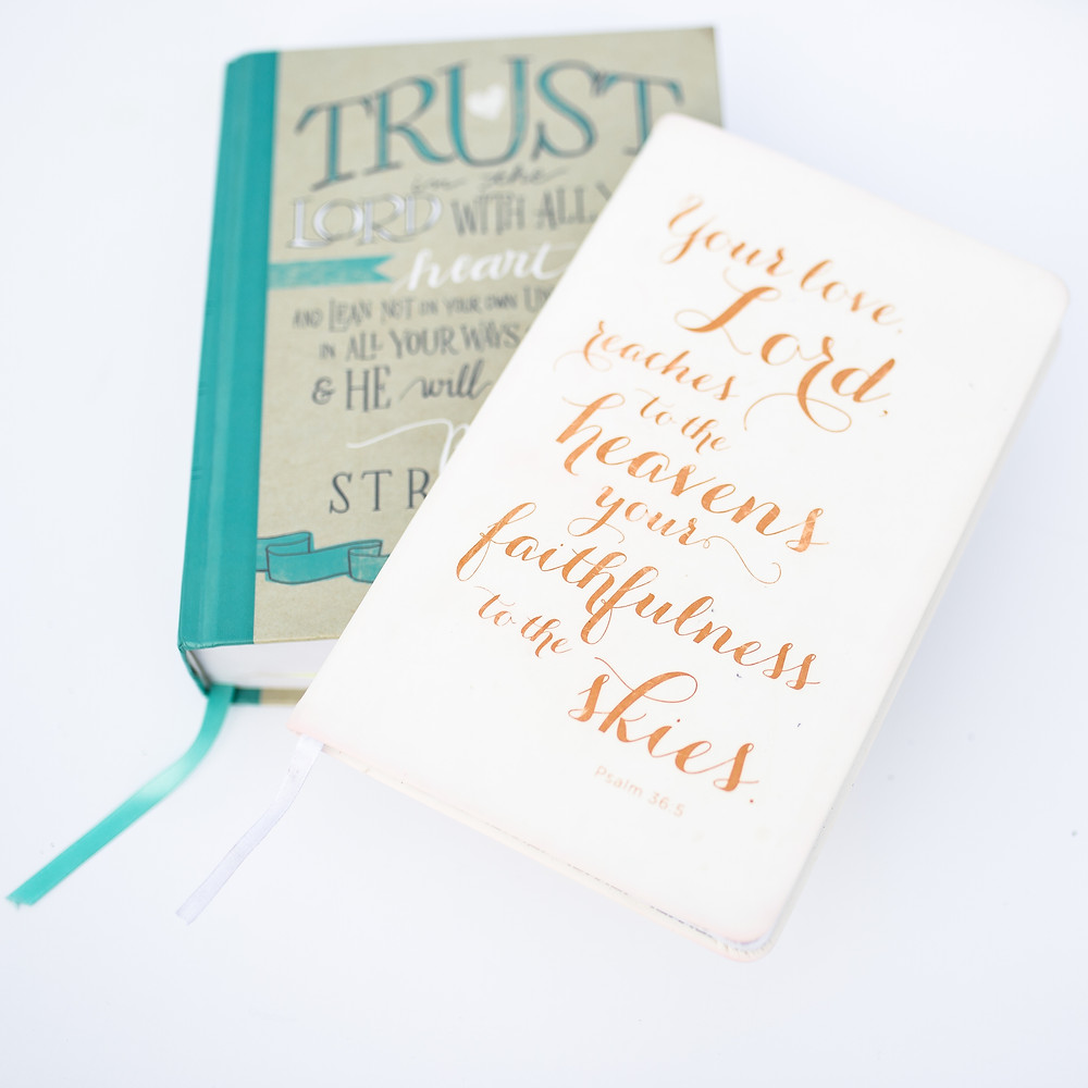 Notebook and Bible with words on trust.