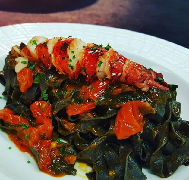 Buttered Poached Lobster on Squid Ink Fettuccine