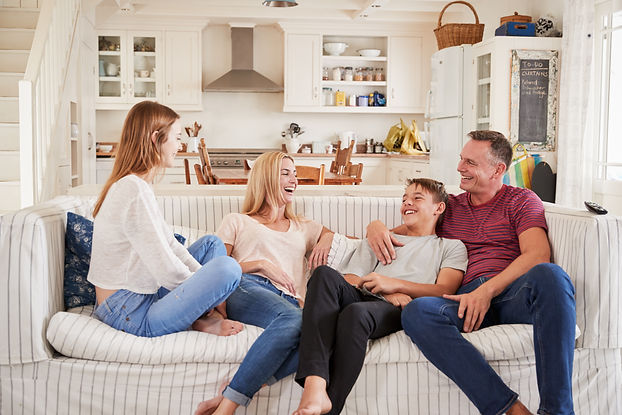 Family With Teenage Children Relaxing On