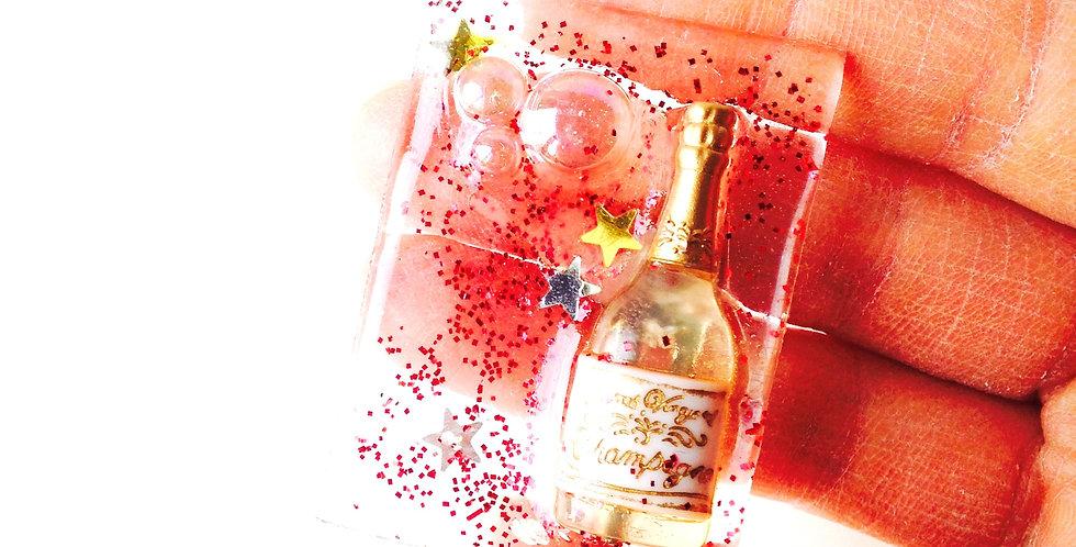 Broche CHAMPAGNE ! transparente dorée glitter, résine bouteille de champagne