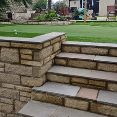 Amazing artificial stone walling with sandstone steps.