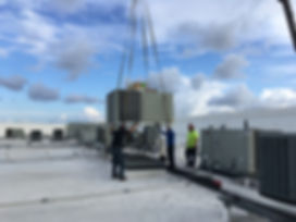 UMI mechanical contractor installing HVAC system on top of Silverspot Cinema in Naples, FL.