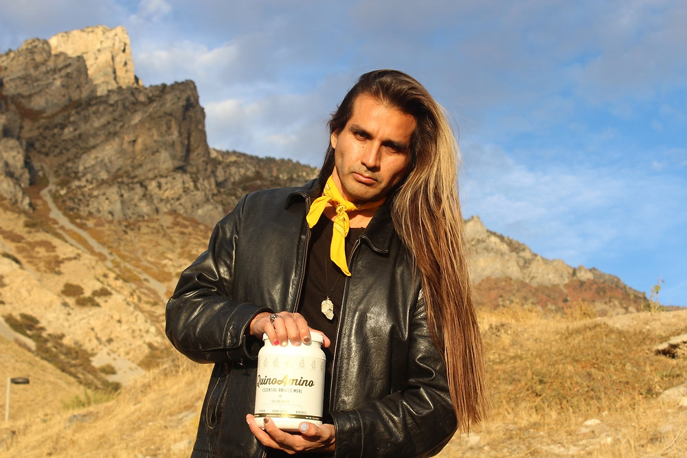 Cesar Valdizan president of Super Seed International holding a QuinoAmino bottle