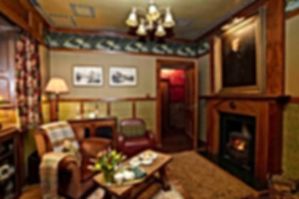 West Cally Lodge living room with cosy log fire