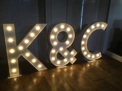 bride and groom light up initials