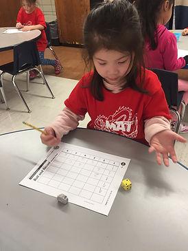Little girl doing math