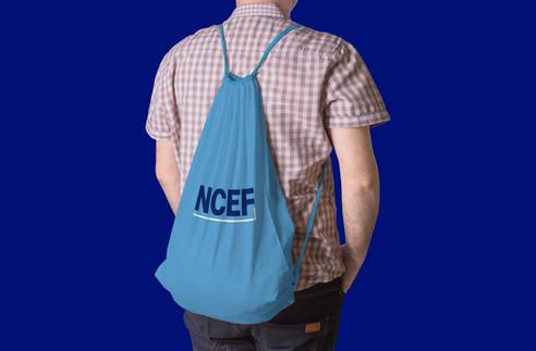 NCEF_Kid with Drawstring Backpack.jpg