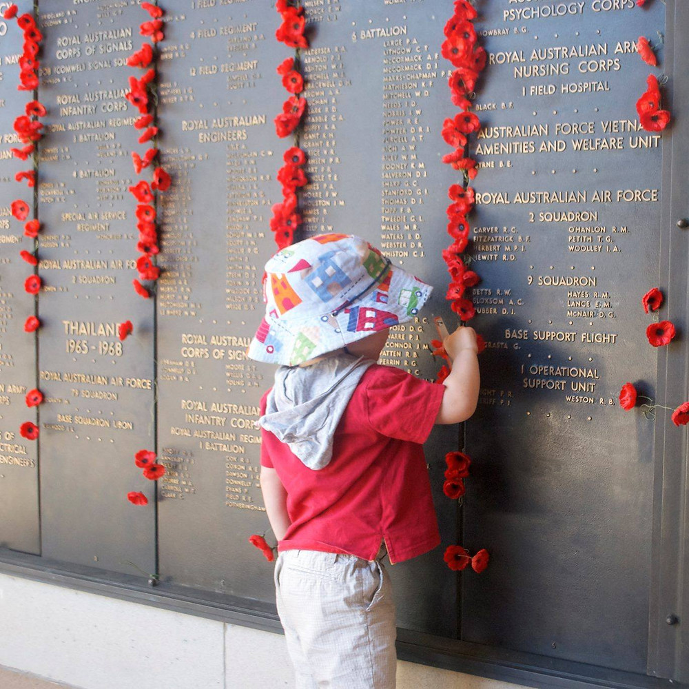 Placing a poppy on the Honour Roll at the Australian War Memorial in Canberra