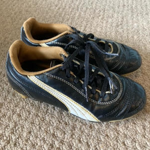 Puma Black and Gold Moulded