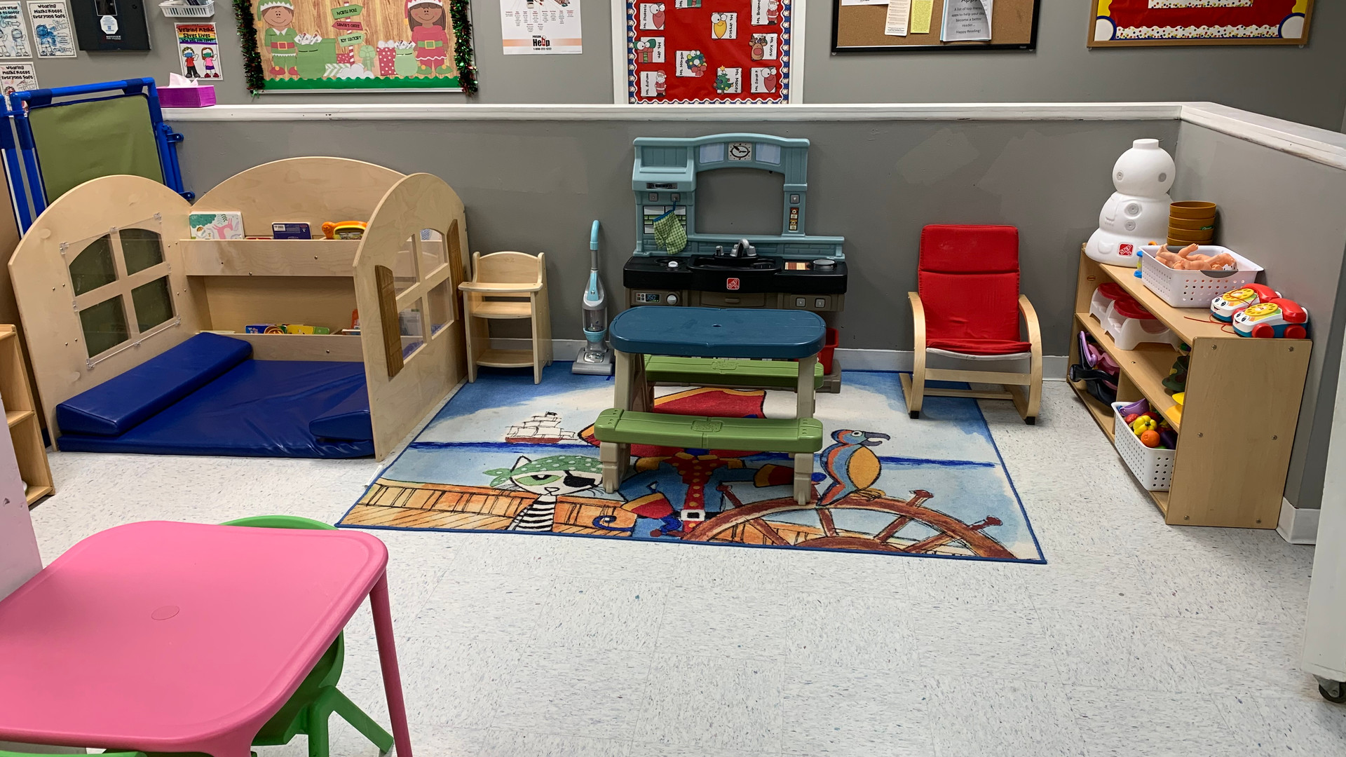 Pretend kitchen/at home play and book nook area.