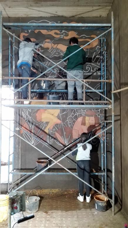 En proceso de la creación del Mural