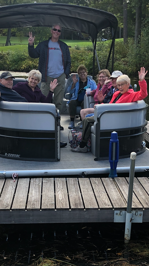 Bill waving with group pontoon ride.PNG