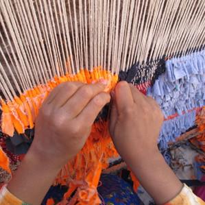 De Carpet of Life weefsters in actie