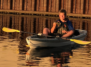 connor +fish in kayak .HEIC