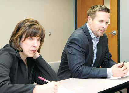 Anne Hazlett, assistant to the secretary for rural development, and Congressman Rodney Davis listen at an opioid meeting at the Montgomery County Health Department on Thursday.