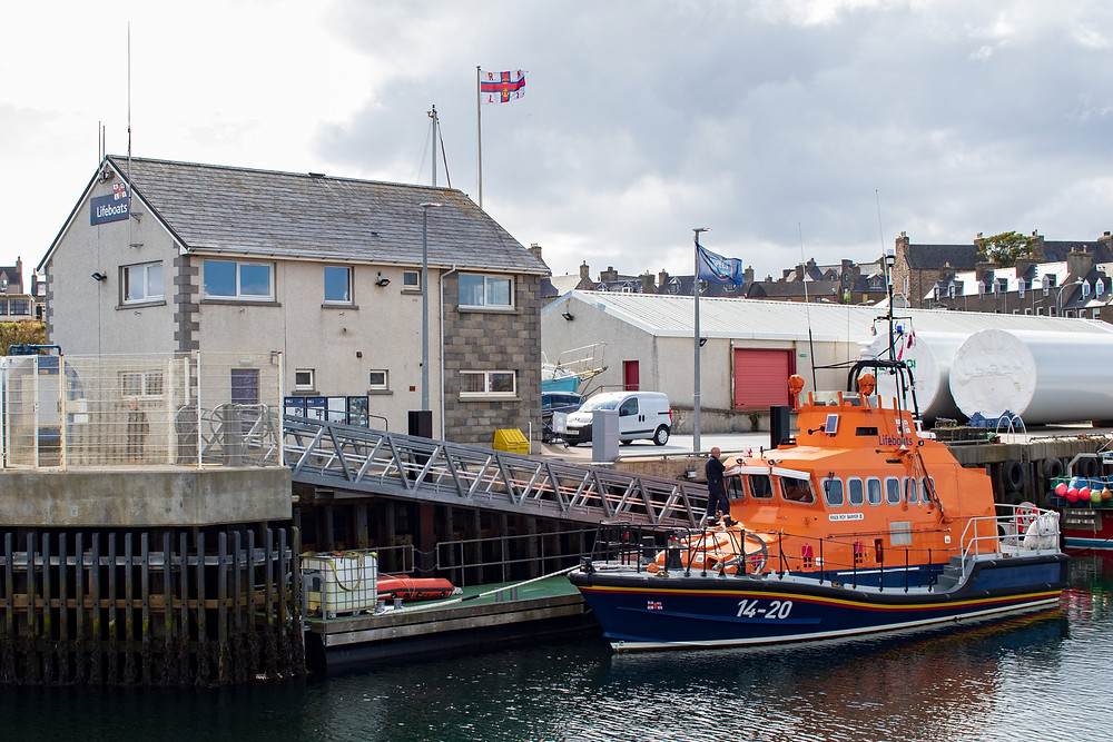 Wick RNLI station and the Trent class Roy Barker II alongside
