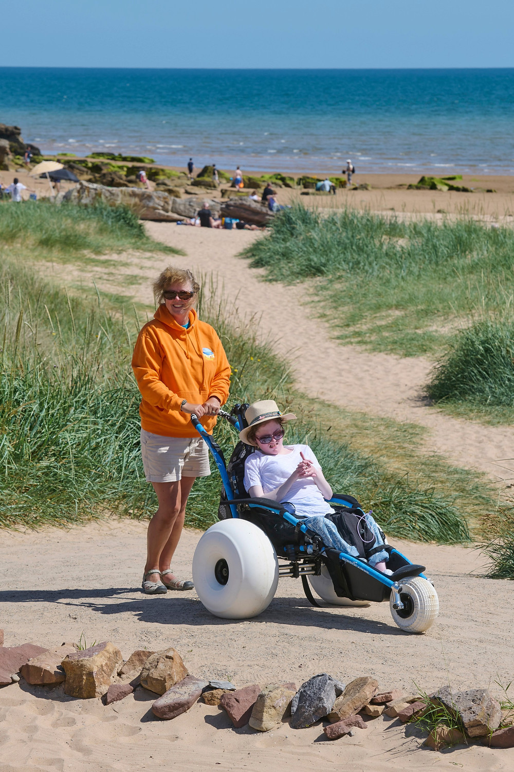 Joanne Murray hits the beach with help from Jenny Shearer from the Dornoch Beach Wheelchairs. The purchase of an electric all-terrain wheelchair means users will be in control of their seaside visit.