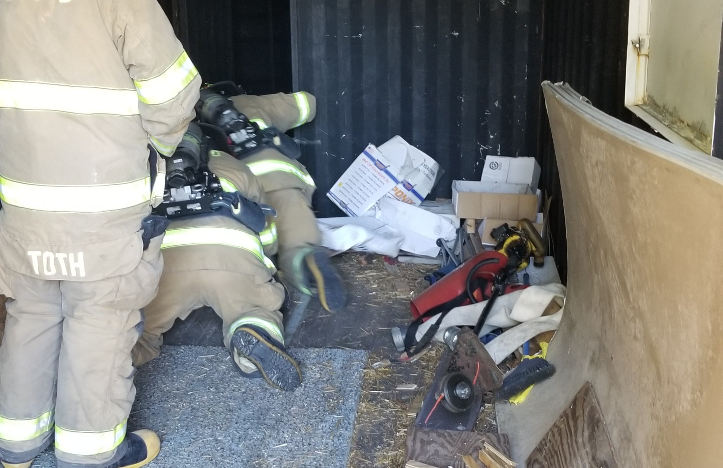 Firefighters crawling in Hot Box.jpg