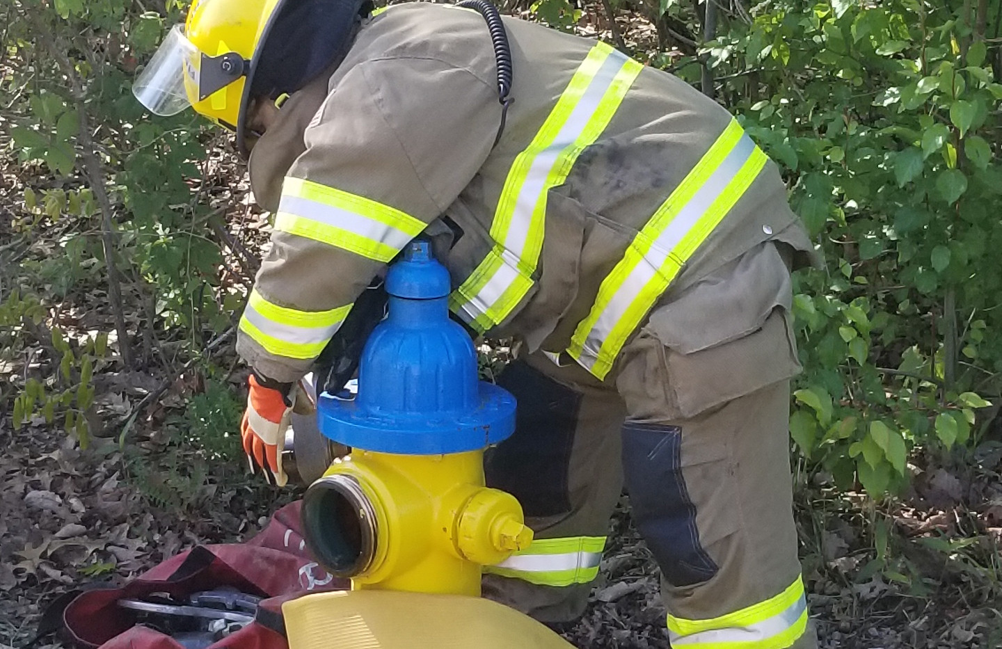 Firefighter Hooking up a hose to Hydrant