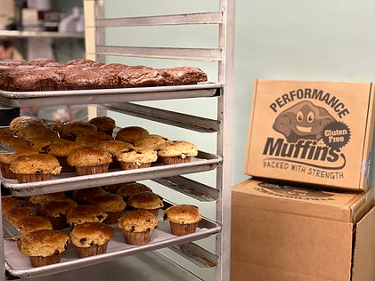 muffin on trays in front of box.jpg