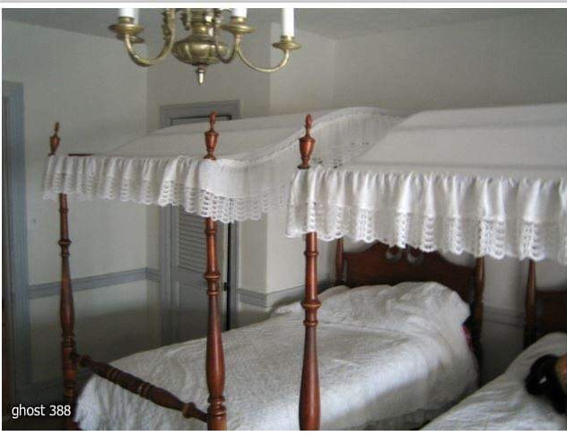 Bedroom at Rosehill with canopy beds