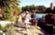 Joggers running past narrowboats along Regent's canal
