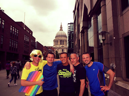 Running tour guests posing for a phto outside St Paul's Cathedral